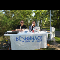 Happy organisers welcoming people at the entrance to BornHack 2016